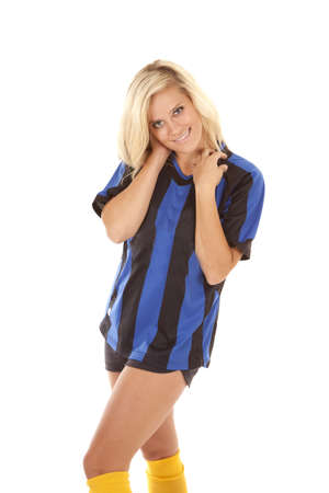 A woman in her black and blue striped uniform with a serious sexy expression on her face.