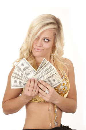 genie woman: A woman genie holding a handful of money in her hands with a cocky grin on her face. Stock Photo