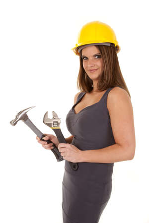 architect tools: A woman with her hard hat on holding on to her tools.
