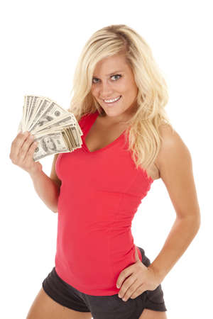 A woman with a fan of one hundred dollar bills in her hand with  a smile on her face. photo