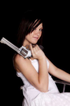 weapons: A woman holding a gun with a small smile on her face.