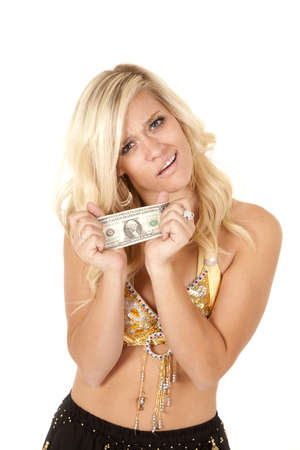 genie woman: a woman in a genie outfit holding on tight to her last dollar with a funny expression on her face.
