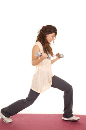 A woman working out stretching and lifting weights. photo