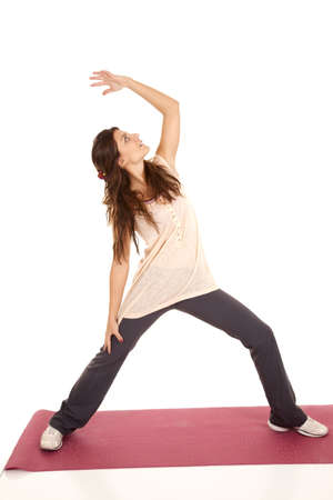 a woman stretching and reaching doing yoga. photo