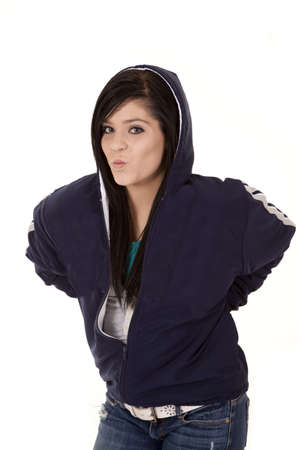 pucker: a teenage girl leaning over in her jacket with her lips in a pucker. Stock Photo