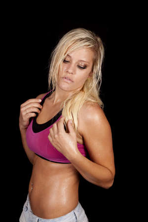 A woman is in a sports bra and very sweaty. photo