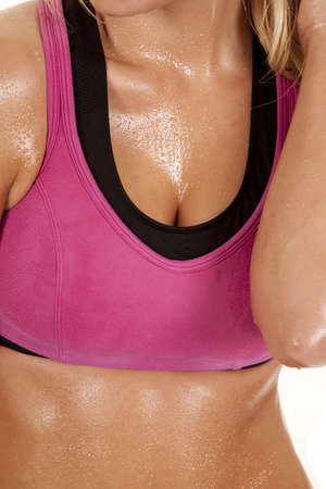 pink bra: A womans body in a pink sports bra.  She is covered in sweat.