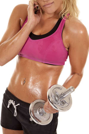sweat girl: A woman is working out with weights.  She is hot and sweaty. Stock Photo