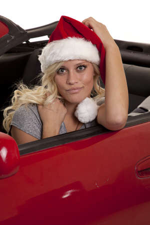 A woman wearing her Santa hat with a big smile on her face. photo