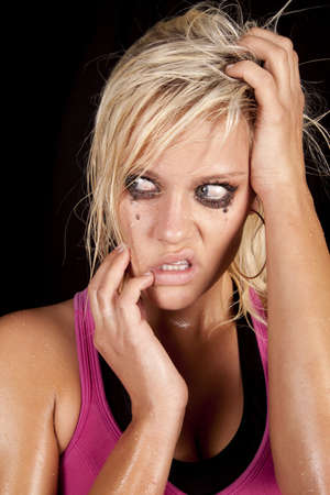 A close up of a woman that is crying and looks very unhappy and sad. photo