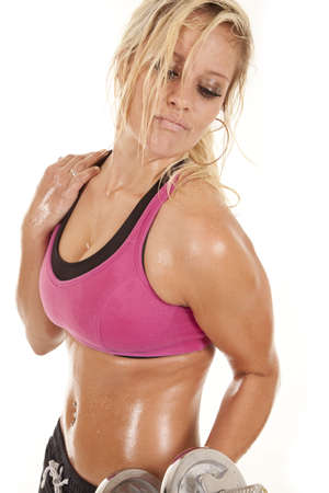 A woman is working out with weights.  She is hot and sweaty. photo