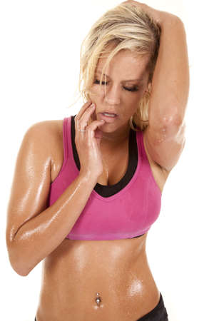 A woman with sweat on her body has her eyes closed. photo