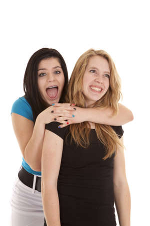 A teen girl holding on to her best friend with a surprised expression on her face. Stock Photo - 12104290