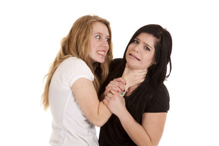 A teenage girl not happy with her friend she is choking her.
