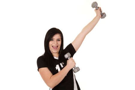 A teenage girl having some fun lifting weights. photo
