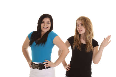stuck up: A couple of teens one is so happy and the other girl is upset. Stock Photo
