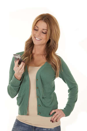 A woman holding her cell phone looking at it. photo