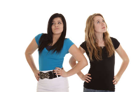 Two teen girl showing how rude and stuck up they are. photo