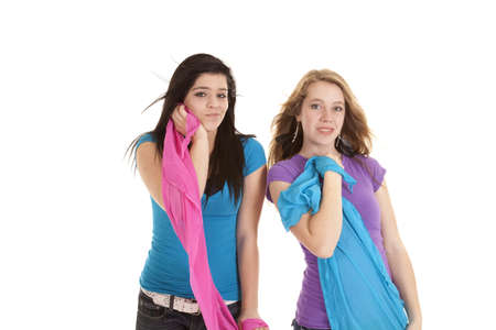 Two teen girls showing off their smiles while posing with colorful sarongs.   Stock Photo - 14611205