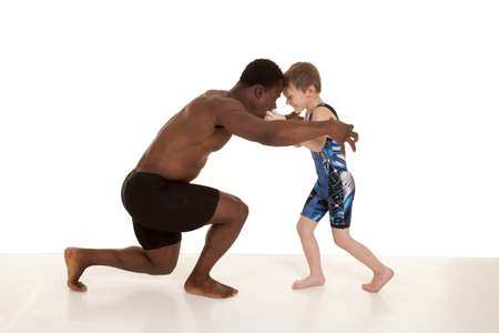 A child and a man getting ready to wrestle. photo