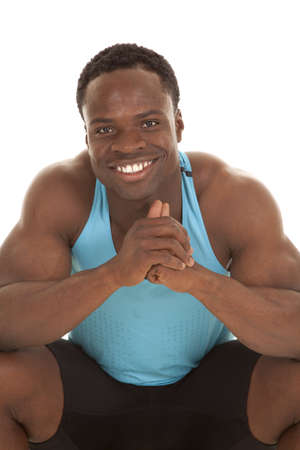 A picture of a man in his blue tank smiling. photo