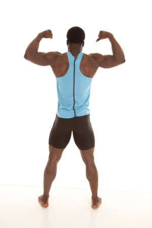 A man showing off his nice developed back muscles by flexing. photo