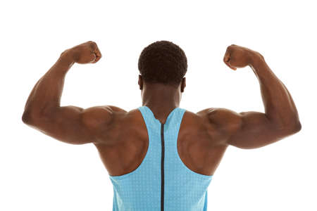 A back view of a man flexing showing off his muscles. photo
