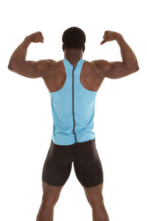 A man standing with his back to the camera showing off his muscles. photo