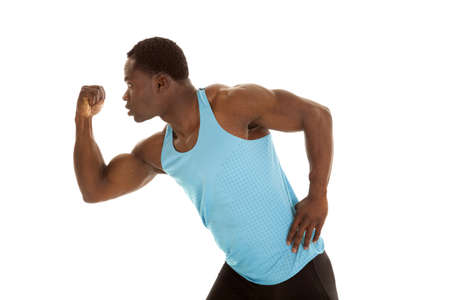 A man showing off his muscles by flexing his arm. photo