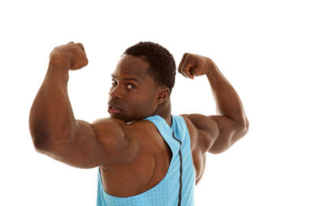 A man flexing his arms while he looks at the camera. photo