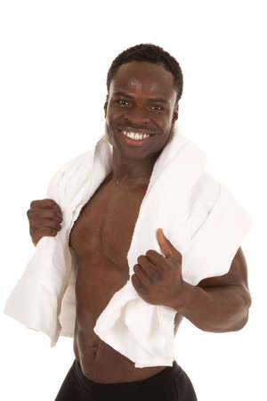 A man with a towel on his shoulders with a smile on his face photo