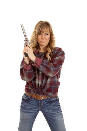 A woman wearing a red plaid shirt holding up a pistol showing a little attitude.