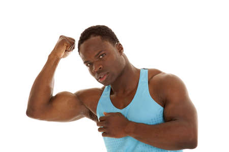 A man flexing his arm looking at the camera. photo