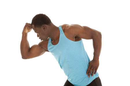 A man looking down at the muscles in his arm. photo