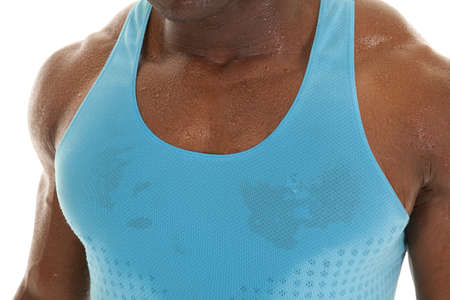 A close up of a mans chest wet and sweaty with a blue tank on. photo