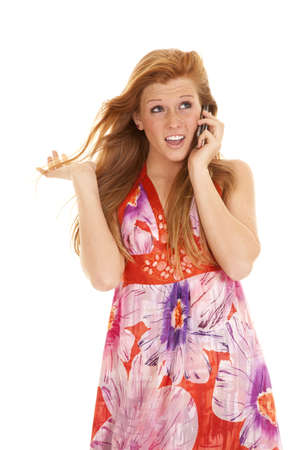 A woman talking on her cell phone with a shocked expression on her face. photo