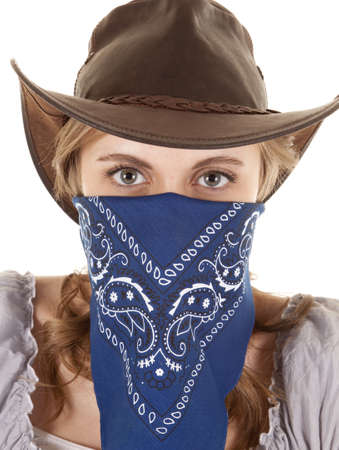 A woman is wearing a bandanna and looking straight forward. photo