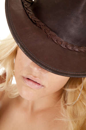 a close up of a woman in her hat with her eyes being hid. photo