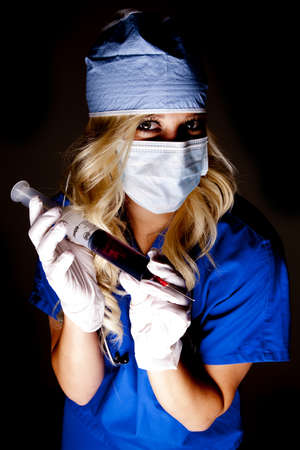 A nurse in a mask with a big needle full of blood.
