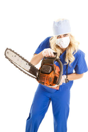 A nurse is holding a chain saw and she has blood on her. photo