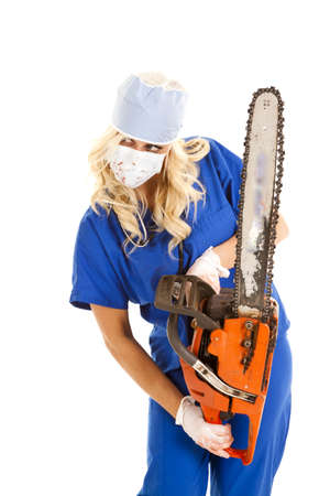 A nurse is holding a chain saw and she has blood on her. Stock Photo