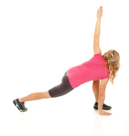 flexable: A woman stretching her back out, trying to get more flexable Stock Photo