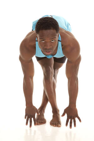 A man bending over and stretching out his legs working on being flexable. photo