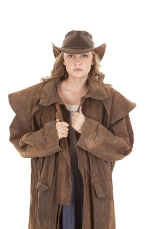 A woman is looking with a cowboy hat and duster on. photo