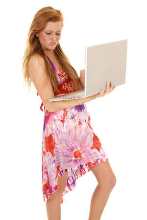 A woman working on her laptop with a little bit of an attitude. photo