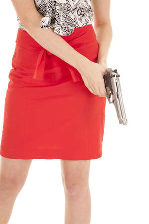 one armed: A woman in a red skirt holding a gun.