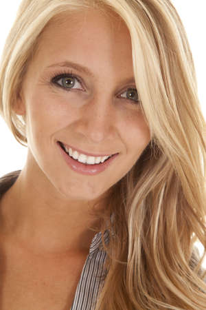 A close up of a womans face with a small smile playing on her lips Stock Photo