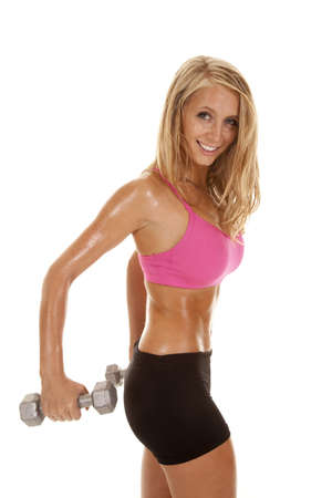 A woman working out with weights with her body all sweaty.