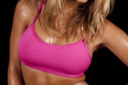 A close up of a womans body sweaty from working out. photo