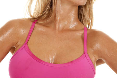 A close up of a womans body sweaty from working out. Stock Photo